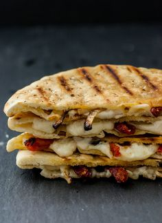 Are you tied of the same old same old lunch routine? Liven it up with this tasty caramelized onion and sundried tomato grilled cheese pita made with white cheddar! Grilled cheese for grownups and kids alike! Veggie Dishes, Caramelized Onions, Food Items, Vegetarian Recipes, Healthy Pita Recipes, A Food, Tasty, Stuffed Peppers, Cooking