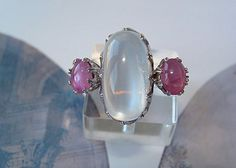 Moon stone cabochon and rose Sapphire ring set in fourteen karat white from…