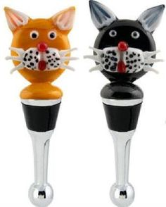 "Orange & Black Halloween Cats Art Glass Wine Bottle Stoppers by L S Arts. $19.98. Brand New in a Covered White Satin lined box - ready for giving. Halloween Bottle Stopper. Orange and Black Cat Bottle Stopper. Measures 4.5"" overall - Cat by itself is 2"" tall by 1.75"" wide. Metal Bottom with Pliable Plastic Seal. What Fun!! These Black & Orange Kitty Cats come in a Set of Two and are but one of several we are offering separately. They are the Ultimate Wine Bottle Stoppers f..."