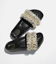 The humble shower slide has ascended to high fashion, with crystal beading, golden grommets and a metallic sheen.