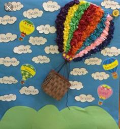 Hot air balloon for the wall or door of classroom. Tissue paper, string, and basket.