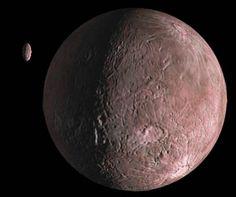 Vue d'artiste de Quaoar et de sa lune Weywot. Son diamètre estimé est de 1 280 kilomètres, ce qui faisait de lui, lors de sa découverte, le plus grand planétoïde du Système solaire.