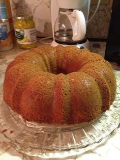 Pumpkin Pound Cake - Pumpkin Pound Cake 1 box yellow cake mix 4 eggs 3/4 cups sugar 1/2 cup oil 1 cup pumpkin 1/4 cup water 1/2 tsp. cinnamon 1/2 tsp. nutmeg Bake 350 degrees for 45 minutes - good plain or with cream cheese icing