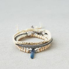 American Eagle Outfitters American Eagle Cream & Gold Arm Party ($18) ❤ liked on Polyvore featuring jewelry, multicolored, gold bracelet, bracelet jewelry, bead bracelet, yellow gold jewelry and gold knot bracelet