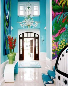 A colorful mural makes for a tropical entryway