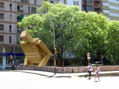 'Box' is a 2006 installation by Argentinian artist Pablo Curutchet that was installed in the city of Cordoba. The enormous man who appears to be emerging from a river Godzilla-style, was constructed of 882 pounds (400 kg) of cardboard boxes with a team of roughly a dozen people.