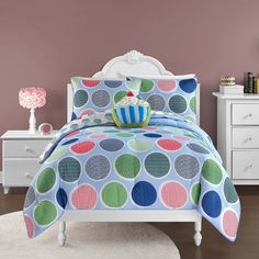 Sweet Thing comforter set is a colorful addition to any bedroom decor. The set includes a cupcakes design comforter and standard shams, which are all machine washable .