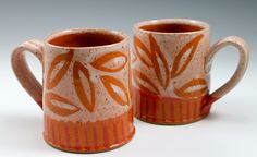 © 2014 Ann Lindell Ceramics | 2 cups | Wheel thrown porcelain, layered glazes, wax resist decoration, ^6 Oxidation.