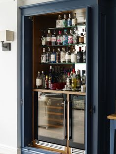 Bespoke Cheshire Cabinet Makers Luxury Quality Hand made Little Greene Co. Cabinets Bone China Blue Spray painted Armac Martin handles Chester Classic Oak Hand crafted Dove tail Design trends Bar alcove alcohol unit wine fridge mirrored backing glass