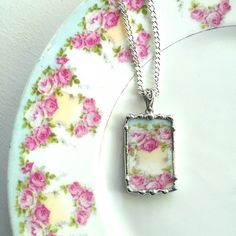 Ecofriendly upcycled antique porcelain china plate turned into a beautiful necklace pendant by Laura Beth Love