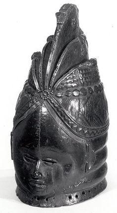Helmet Mask (Bundu) Date: 19th–20th century Geography: Sierra Leone Culture: Mende peoples Medium: Wood, metal, pigment