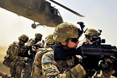 U.S. Army Pfc. Samuel Corsolini uses his weapon's scope to provide security as a UH-60 Black Hawk helicopter takes off after unloading U.S. and Afghan troops during a vehicle interdiction to disrupt Taliban activities as part of Operation Pranoo Verbena in Kandahar province, Afghanistan, March 16, 2012. Corsolini is a gunner assigned to the Company F, 2nd Battalion, 25th Aviation Regiment, 25th Combat Aviation Brigade. (Photo by Sgt. Daniel Schroeder) #aviationhumorgoogle