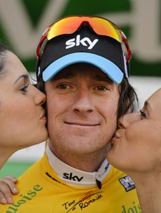 Two women kiss Britain's Bradley Wiggins during the ceremony of the second stage of the Tour de Romandie cycling race, a 149,1 km stage from Montbeliard to Moutier, on April 26, 2012 in Moutier. Frenchman Jonathan Hivert of the Saur-Sojasun team dominated an uphill sprint at the end of the Tour of Romandie's second stage as Britain's Bradley Wiggins retained the overall lead. AFP PHOTO / FABRICE COFFRINIFABRICE COFFRINI/AFP/GettyImages