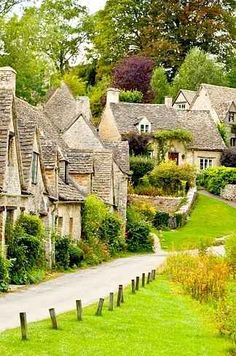 """Bibury, England """"This old village is known for both its honey-colored stone cottages with steeply pitched roofs as well as for being the filming location for movies like Bridget Jones' Diary. It's been called 'the most beautiful village in England."""