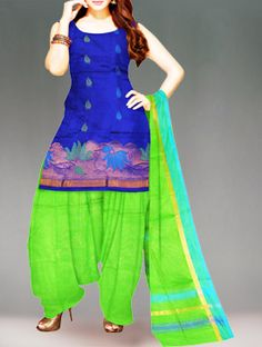 Shop online designer pure uppada silk pattu punjabi suit at unnatiislks.com Blue and parrot green color Uppada pure silk punjabi suit with matching chunni.This dress material has got all over blue,green floral thread weaving and zari floral bootis along with zari border kameez.And it has parrot green silk plain salwar with zari border dupatta.It is apt for party and wedding wear. To purchase online uppada pure silk salwar kameez please visit our site http://www.unnatisilks.com