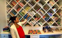 """Loving this """"fab"""" children's bookshelf (or rather book wall) in Kourtney Kardashian's home, which contains a mix of classics, vintage books, and some of her own childhood favorites.  It's a modern, clean look which adds a pop of color, dimension and texture to the room.  What a great way to preserve your favorite books and prevent kids from throwing all of their books on the floor!"""