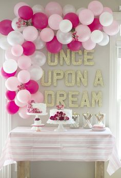Sleeping beauty party, dessert table, pink, floral balloon arch, once upon a dream