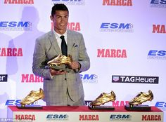 Cristiano Ronaldo poses with the European Golden Boot after becoming top scorer on the continent last term