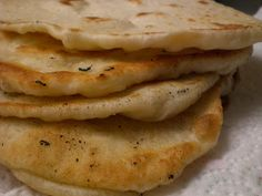 I have only tried the Naan recipe from this link.  It made it in my Kitchen-Aid instead of kneading by hand. :)