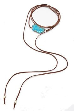 Jewelry – Lyn Evans  Statement necklaces are so popular for the season. Wrap leather band with a statement bead.