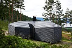 Crisscross Shaped Cabin Norderhov by Atelier Oslo with amazing views of the surrounding forest...