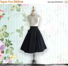 Faux Fur Black Mid Calf Circle Skirt with side pockets Hig Waisted Circle Skirt Fabric - Cotton Lycra Very nice soft fabric These skirts are new.