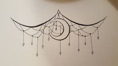 Chandelier and moon sternum under boob tattoo. Beautiful, but the moon is kinda randomly thrown in...I'd take it out.