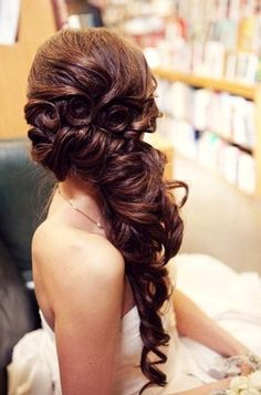 "Great for a formal event, gorgeous ""wave-like"" styled hair twisted into curls is stunning."