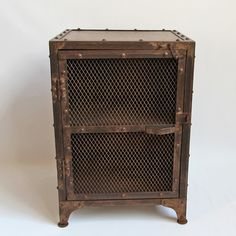 Aged iron bedside cabinet or small storage cabinet with iron rivet details and iron mesh door.