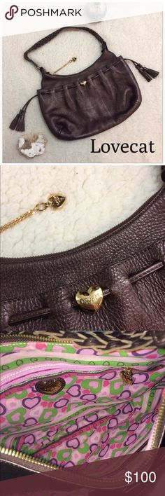 "Lovecat Paris Metallic Brown Leather Hobo Bag Gorgeous slight Metallic piece with tassel embellishments and gold emblems. The interior has a beautiful heart pattern for the lovecat brand it has NO FLAWS! 13"" across x 9"" deep. Braided strap drop is 10"" Lovecat Bags Hobos"