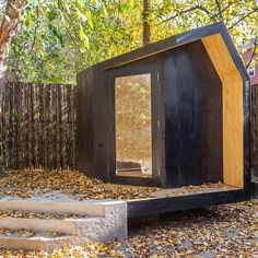 Tucked away at the bottom of a Brooklyn garden, this tiny cedar-clad pavilion was designed as a retreat for a pair of writers. The 50-square-foot (4.6 square metres) interior of the structure is made entirely of pine plywood, furnished with a folding desk, a chair, and a built-in sofa. See a full set of images on dezeen.com #architecture #USA #Brooklyn