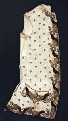 Waistcoat  Date:     1755–65 Culture:     French Medium:     silk, metallic Dimensions:     Length at CB: 33 1/2 in. (85.1 cm) Credit Line: Accession Number: C.I.60.22.47