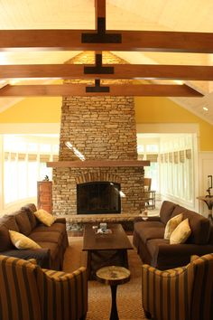A bright living room with beams and a vaulted ceiling. | to see more of the project, visit http://studioduo.net