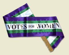 This pin shows a Suffragette sash. It embodies the colors of the movement: purple, green, white, and gold. Women Suffragette, Suffragette Colours, Miss Poppins, Deeds Not Words, Emmeline Pankhurst, Suffrage Movement, Protest Signs, Women In History, Lettering