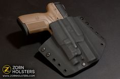 Our Trojan concealment holster fitted for an FN Five-seveN with a Viridian C5L.