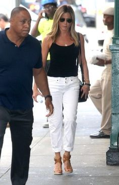 Jennifer Aniston Wedges - Jennifer Aniston styled her casual look with strappy tan wedges by Burberry.