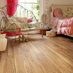 Polyflor Camaro Nut Tree 2202 Vinyl Flooring offers a lively grain and colour. This heavily marked character wood can really help bring a room to life. The strong variation in tone along with its natural beauty will offer a dramatic addition to any room.