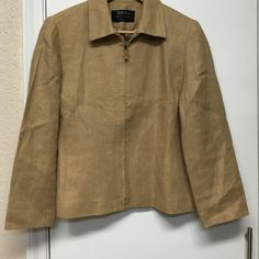Dana Buchman Excellent condition. Linen blazer. Fully lined. Zipper closure. Light shoulder pads. Petite size. No stains or rips. Trying to make room in my closet! Dana Buchman Jackets & Coats