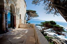Restored to its 1920s majesty, the enchanting Crocker-Fagan mansion stands its ground amid Monterey's windswept cypresses.