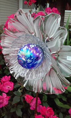 Upcycled glass garden art by Kimber's Garden Gems on Facebook