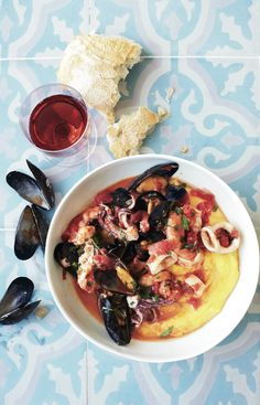 Shellfish-Tomato Stew on Soft-Cooked Polenta // More Polenta Recipes: http://www.foodandwine.com/slideshows/polenta #foodandwine