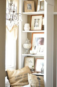 Family Photos, etc displayed on a bookcase make an appealing vignette.