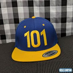 The key to survival is wearing this 101 Embroidered Cosplay High Quality Cap!  Grab this cap to ensure a foolproof way to make it through the harsh wastelands, spot other survivors and band together to keep moving forward!     #Vault101 #101 #76 #PipBoy #Cosplay #Gamers #VideoGames #RPG #RolePlayingGames #HighQuality #Snapback #Embroidered #Hats #Caps #Gifts