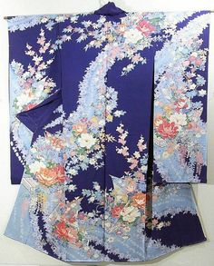 This is a kimono silk fabric cut into Furisode shape and stitched roughly before sewing to make furisode.   It has gorgeous flower boat full of 'Kiku'(chrysanthemum) and 'Botan'(peony) and beautiful classical pattern, which is dyed on the chic bluish purple background