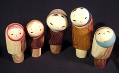 Japanese Mid Century Snow Country Kokeshi Doll Family Yukinko This is a pristine 1960's mid century Japanese wooden Kokeshi doll family that measures between 3.75 and 2.88 inches high. It depicts a Japanese family from the cold snow country region of Japan each wrapped in a warm coat and a head scarf. Judging by the way their bodies are hunched forward, they are all so very cold as they try to fight off the blistering wind.