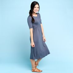 Soft knit dress with lace trim and pockets Approximate bust measurement: Small – 34″      Medium – 36″      Large – 38″ Approximate length: Small – 42″ Medium – 42.5″ Large – 43″ Fabric content: Rayon, Spandex