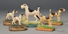 "Two Pairs of Cast Iron Terrier Bookends and a Terrier Doorstop, America, early 20th century, polychrome-painted bookends and doorstop, the doorstop with impressed ""PAL CORP."" maker's mark, ht. 4 1/2, 5 1/4, 7 in.   Sold for $ 415"