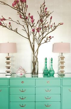 Blue walls, gray dresser, glass cylindrical vase with long stem flowers. My ideas for the guestroom!