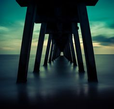 This is a long exposure of about two minutes under Florida's Venice Pier at night. The water appears still and the night appears brighter than it is. In fact I had people walking in front of me yet the length of the exposure ensures they are invisible. I shot this same perspective at sunset a few years ago and now it was time to come back. The evening perspective is one I quite like, it just seems less rushed and a bit more dreamy. Dreamy is a good word for a night shot, don't you think?