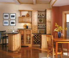 Wine with friends almost always guarantees a good time. If you've ever considered a tasting room, let us show you how it's done! Combining a variety of wine cubbies with a criss-cross wine rack keeps your vintage close at hand. Rustic Alder cabinets with open shelving and glass doors give easy access to serveware and other necessities for pulling off the perfect party. You're ready to send the invitations - the raised bar stands ready for folks to gather round!